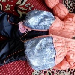 A new children's costume for a girl. Spring is autumn.