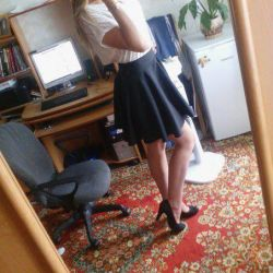 The skirt is black. Black shoes