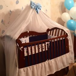 Canopy, holder and skirt on the crib
