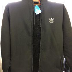 Куртка тeплая трикотаж с искусственным мехом.