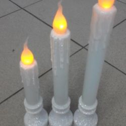 LED candles with imitation of a glow of a flame