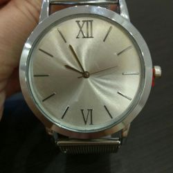 Watch with a metal strap.