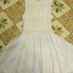 The dress is white lace,