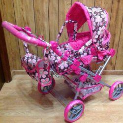 Çapraz geçiş kolu ile bebekler için taşıma arabası