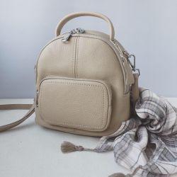 New bag made of genuine leather beige beige