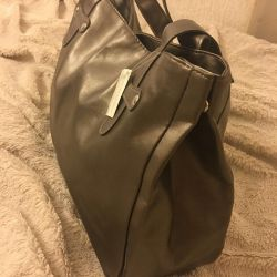 New leather bag with tag and beautician