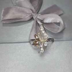 The ring is made of 925 silver. Size 18