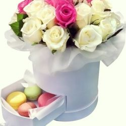 Roses in the box. Gift box with macaroons