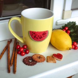 Mugs decorated with polymer clay.