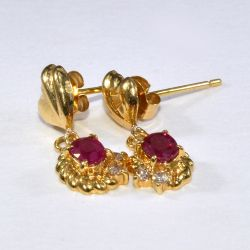 Gold earrings with rubies and diamonds 750