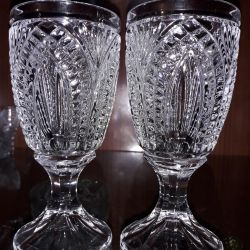Crystal candlesticks and wine glasses.