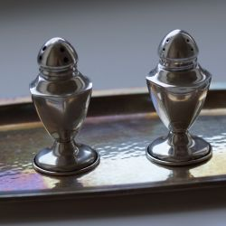 Antique silver salt shaker and pepper shaker