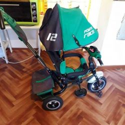 Tricycle for children with a cursor for mom