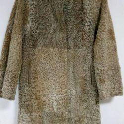 The fur coat is astrakhan. vintage