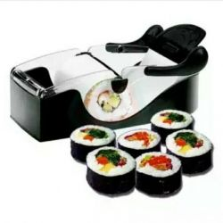 Machine for making rolls and sushi