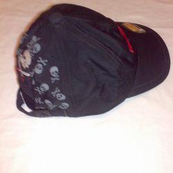A baseball cap is black for a boy.
