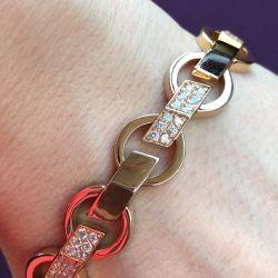 Золотой женский браслет с фианитами 33,33 гр