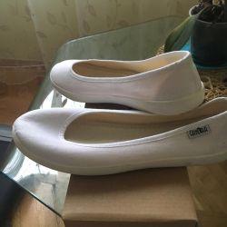 Selling white textile ballet shoes
