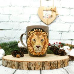 A lion. Polymer clay mug decor