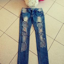 Jeans with holes.