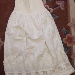The skirt is long white