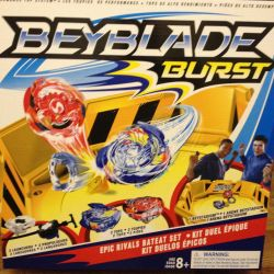Tops Beyblade with a large yellow arena