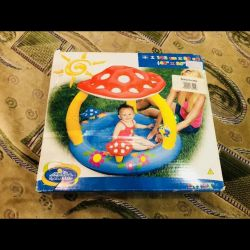 new inflatable pool for baby + balloons.
