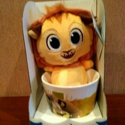 Cup with a toy lion