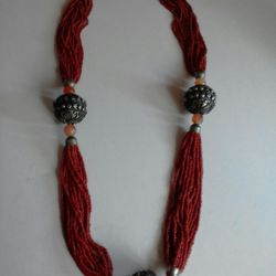 Coral beads with carnelian and chasing (enamel)