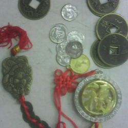 Chinese coins, symbols of wealth.