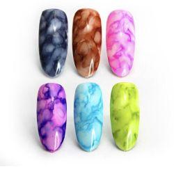 Watercolor drops for nail design.