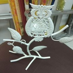Candlestick owl on the branch
