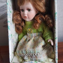 Porcelain doll. Manufacturing China.