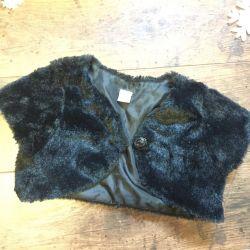 Vest fur on the girl