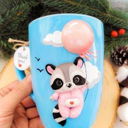 Raccoon on a ball of polymer clay. Mug decor