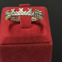 White gold ring with crown cubic zirconias
