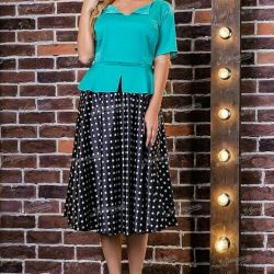 Menthol suit with a midi skirt