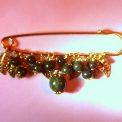 Brooch pin with natural stones coil