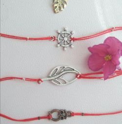 Red threads with pendants