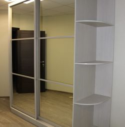 The sliding wardrobe is mirror, aluminum with dividers