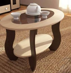 Coffee table with oval glass