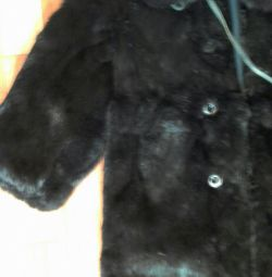 Fur coat for a girl from a rabbit.