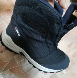 In the presence of new men's boots winter