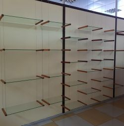 Hanging glass shelves in a wooden frame
