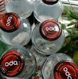 Продам стеклянные бутылки с крышками емкостью 1 л