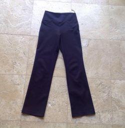 Pantalonii sunt școală, albastru, soluția 116-122