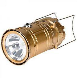 Lampa cu lanterna pentru camping pe o baterie solară.