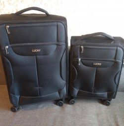 New black solid suitcase for 58 and 35 liters