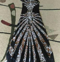 The dress is long, classy