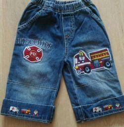 Jeans pentru un băiat de 6-9 luni